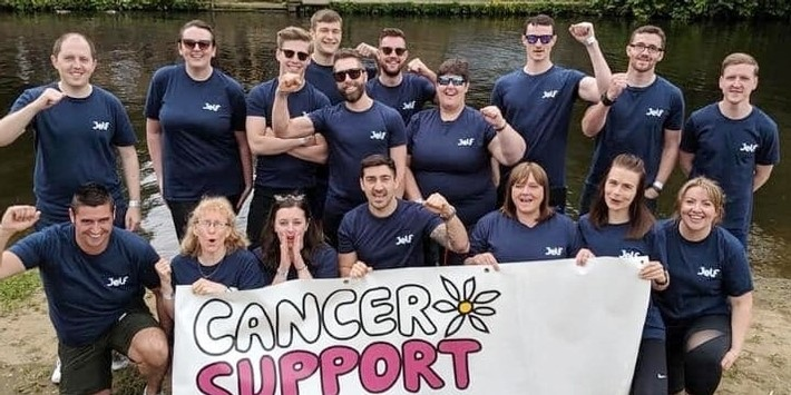 Jelf colleagues take part in a dragon boat race